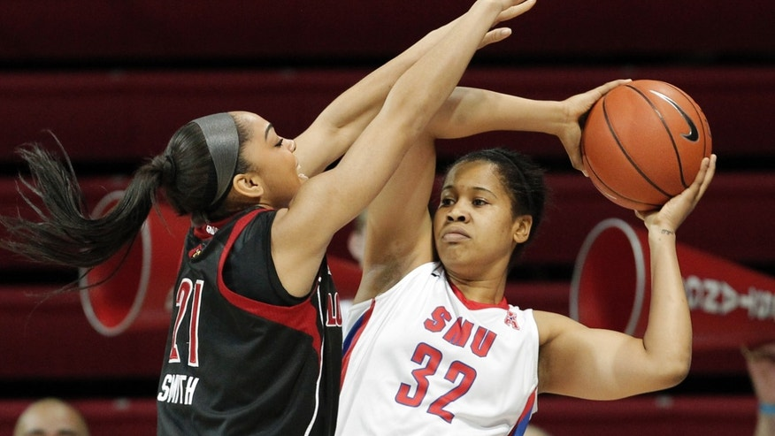 SMU guard Raven Short (32) looks to pass as Louisville's Bria Smith (21) defends in the first half of an NCAA college basketball game on Sunday, Jan. 19, 2014, in Dallas. (AP Photo/Brandon Wade)