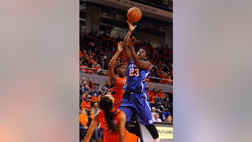 Auburn's Tyrese Tanner (32) draws a charge from Kentucky's Samarie Walker (23) who shoots during the first half of an NCAA college basketball game on Sunday, Jan. 19, 2014, in Auburn, Ala. (AP Photo/Butch Dill)