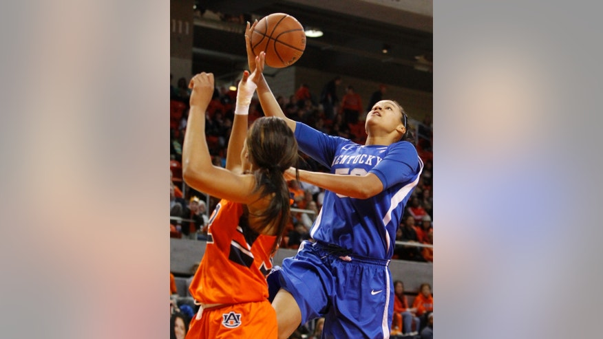 Kentucky;s Azia Bishop, right, goes up to shoot over Auburn's Tyrese Tanner during the first half of an NCAA college basketball game on Sunday, Jan. 19, 2014, in Auburn, Ala. (AP Photo/Butch Dill)