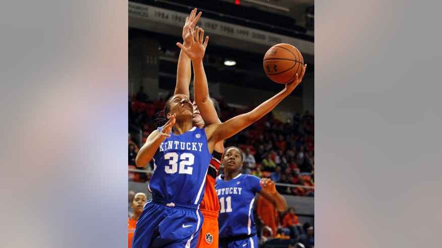 Kentucky's Kastine Evans (32) is fouled by Auburn's Peyton Davis while shooting during the first half of an NCAA college basketball game on Sunday, Jan. 19, 2014, in Auburn, Ala. (AP Photo/Butch Dill)