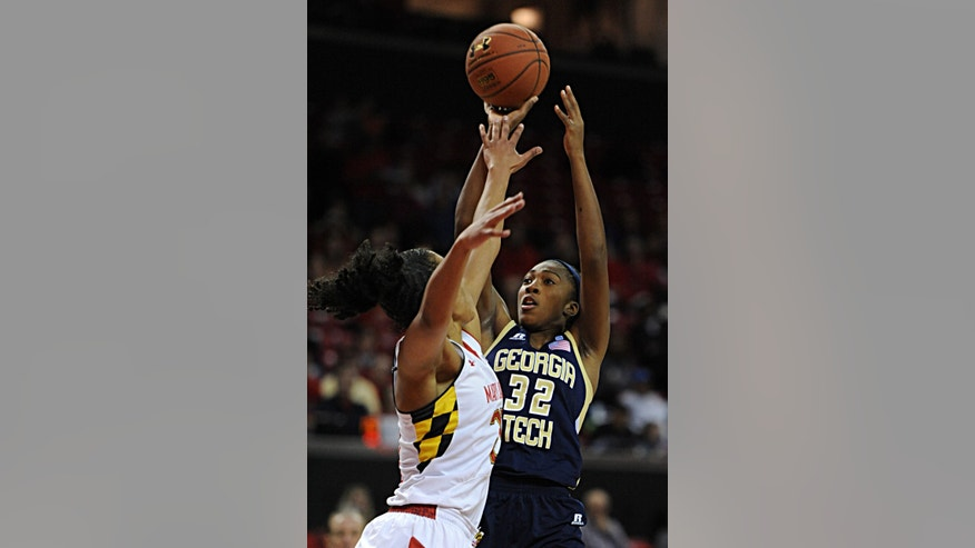 Maryland's Alyssa Thomas, left, tries to block a shot by Georgia Tech's Donnaizha Fountain in the first half of an NCAA college basketball game on Sunday, Jan 19, 2014, in College Park, Md. (AP Photo/Gail Burton)