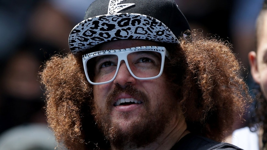 Music artist Redfoo watches his girlfriend Victoria Azarenka of Belarus play Sloane Stephens of the U.S. during their fourth round match at the Australian Open tennis championship in Melbourne, Australia, Monday, Jan. 20, 2014. (AP Photo/Aaron Favila)