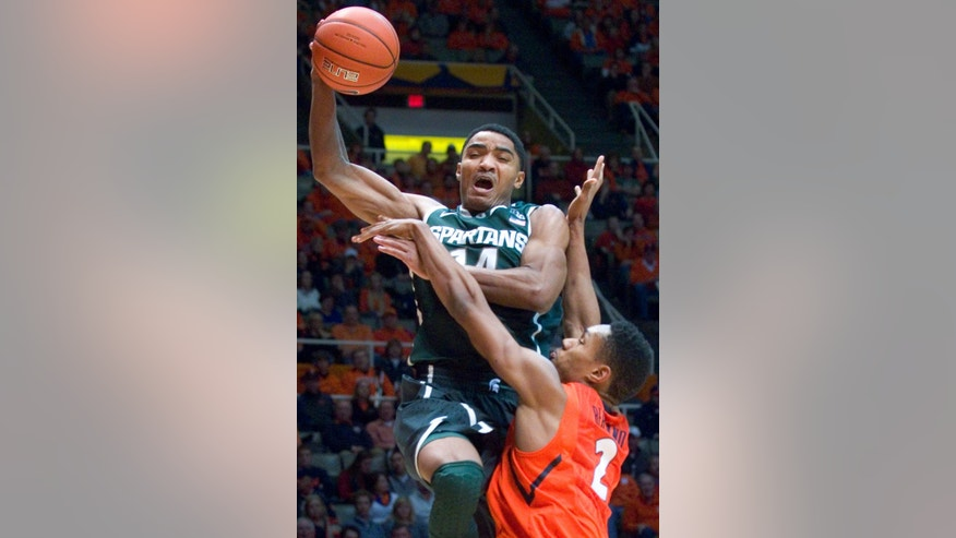 Michigan State guard Gary Harris (14) goes up over Illinois' Joseph Bertrand (2) during an NCAA college basketball game Champaign, Ill., on Saturday, Jan. 18, 2014. (AP Photo/Robin Scholz)