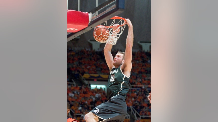 Michigan State forward Matt Costello dunks during an NCAA college basketball game in Champaign, Ill., on Saturday, Jan. 18, 2014. (AP Photo/Robin Scholz)