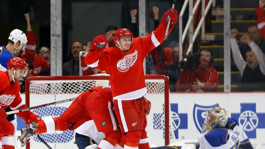 Detroit Red Wings center Gustav Nyquist (14), of Sweden, celebrates his goal against St. Louis Blues goalie Jaroslav Halak (41), of the Czech Republic, in the first period of an NHL hockey game, Monday, Jan. 20, 2014, in Detroit. (AP Photo/Paul Sancya)