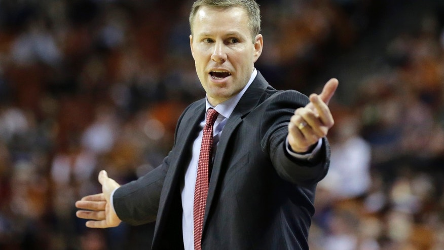 Iowa State coach Fred Hoiberg talks to his players during the second half on an NCAA college basketball game against Texas, Saturday, Jan. 18, 2014, in Austin, Texas. Texas won 86-76. (AP Photo/Eric Gay)