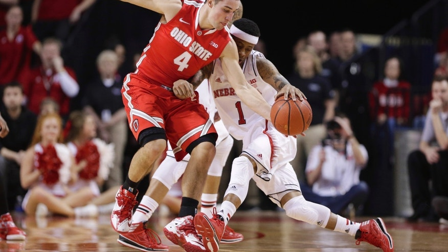 Ohio State guard Aaron Craft (4) steals the ball from Nebraska's Deverell Biggs (1) in the first half of an NCAA college basketball game in Lincoln, Neb., Monday, Jan. 20, 2014. (AP Photo/Nati Harnik)