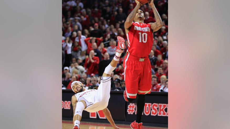 Ohio State forward LaQuinton Ross (10) shoots as Nebraska's Terran Petteway (5) falls down, in the first half of an NCAA college basketball game in Lincoln, Neb., Monday, Jan. 20, 2014. (AP Photo/Nati Harnik)