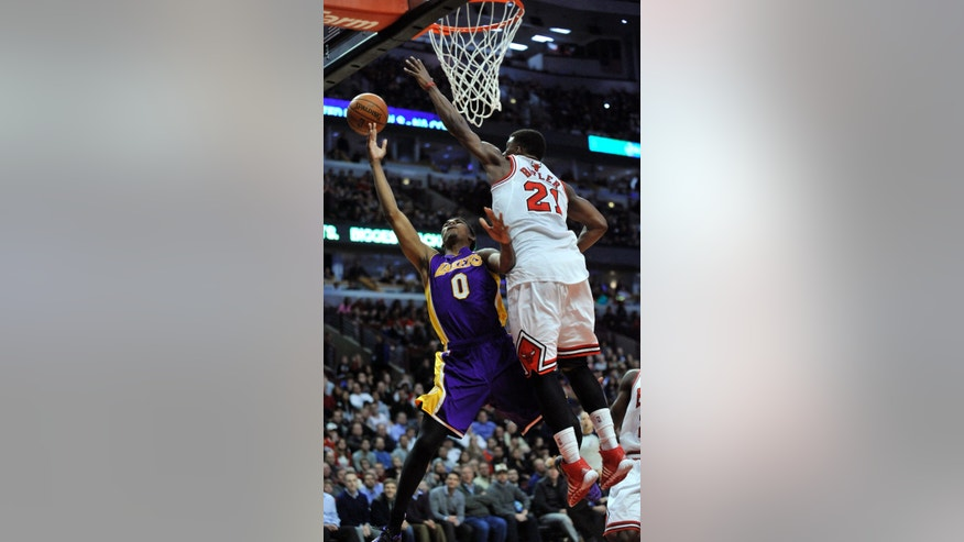 Los Angeles Lakers' Nick Young (0) goes up for a shot against Chicago Bulls' Jimmy Butler (21), during the fourth quarter an NBA basketball game in Chicago, Monday, Jan. 20, 2014. Chicago won 102-100, in overtime. (AP Photo/Paul Beaty)