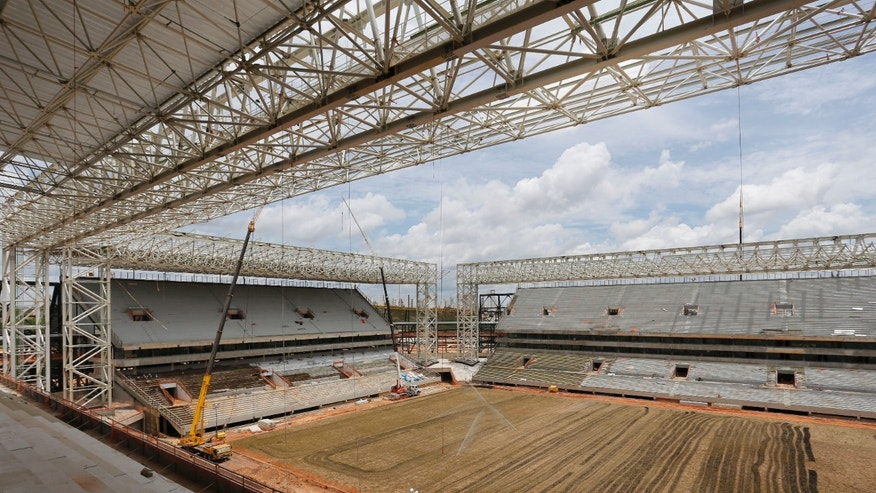 In this  Dec. 9, 2013 photo, a view of the pitch of the Arena Pantanal in Cuiaba, Brazil. At Arsenal's Highbury Stadium, Edu played on one of football's finest pitches. Award-winning Arsenal groundsman Paul Burgess became so well-known for his green fingers that he was eventually lured away by Real Madrid. So when Edu returned home to Brazil in 2009 to finish his career, the worn and sorry state of some Brazilian football fields was an eye-opener. Even now, as the World Cup host rushes to ready itself, Edu says pitches in Brazil aren't on a par with those in Europe, where he played for eight years, at Arsenal and Valencia. (AP Photo/Ferdinand Ostrop)