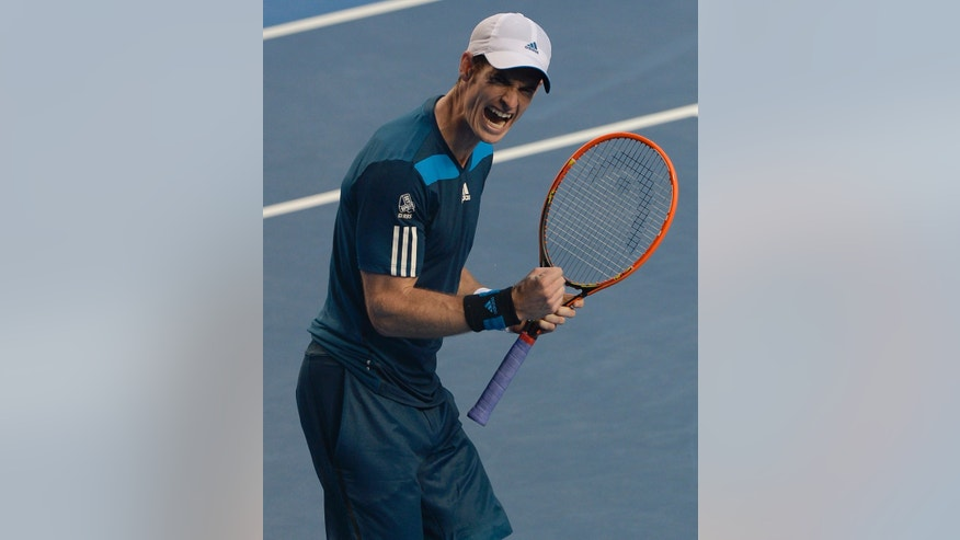 Andy Murray of Britain celebrates after defeating Stephane Robert of France in their fourth round match at the Australian Open tennis championship in Melbourne, Australia, Monday, Jan. 20, 2014.(AP Photo/Andrew Brownbill)