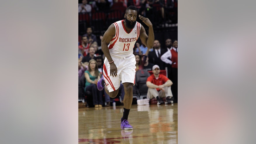 Houston Rockets guard James Harden (13) motions after hitting a three-point shot against the Portland Trail Blazers during the first half of an NBA basketball game, Monday, Jan. 20, 2014, in Houston. (AP Photo/Bob Levey)