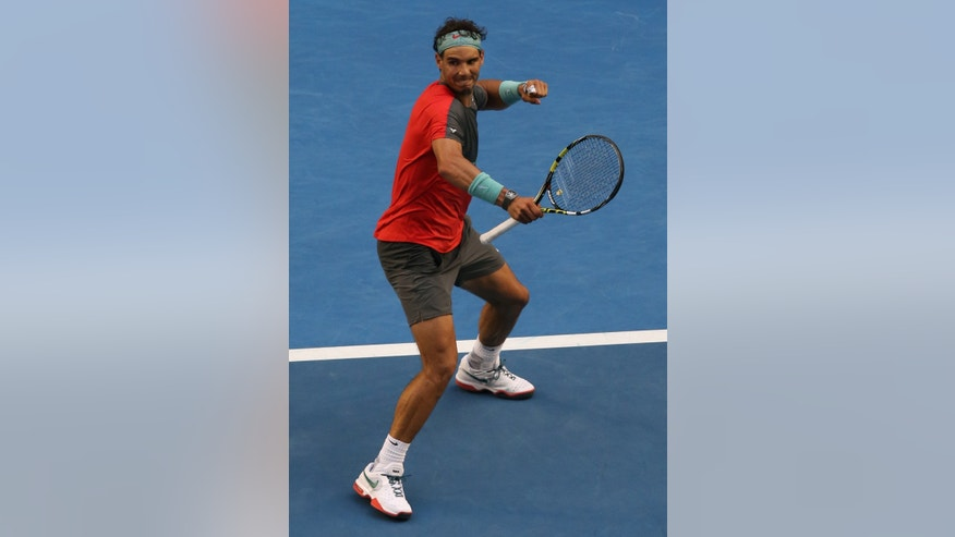 Rafael Nadal of Spain celebrates after defeating Kei Nishikori of Japan  during their fourth round match at the Australian Open tennis championship in Melbourne, Australia, Monday, Jan. 20, 2014.(AP Photo/Eugene Hoshiko)