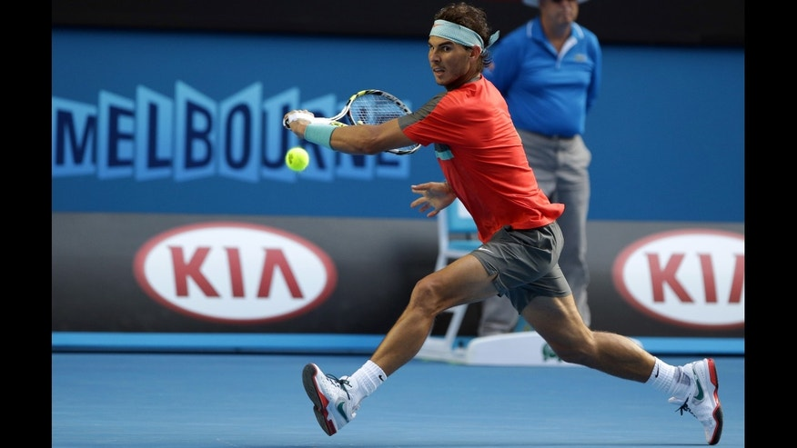 Nadal reaches for a ball to Nishikori during their fourth round match at the Australian Open in Melbourne, Australia, Jan. 20, 2014.