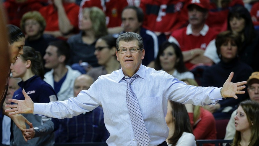 Connecticut head coach Geno Auriemma reacts to play during the first half of an NCAA college basketball game against Rutgers, Sunday, Jan. 19, 2014, in Piscataway, N.J. Connecticut won 94-64. (AP Photo/Mel Evans)