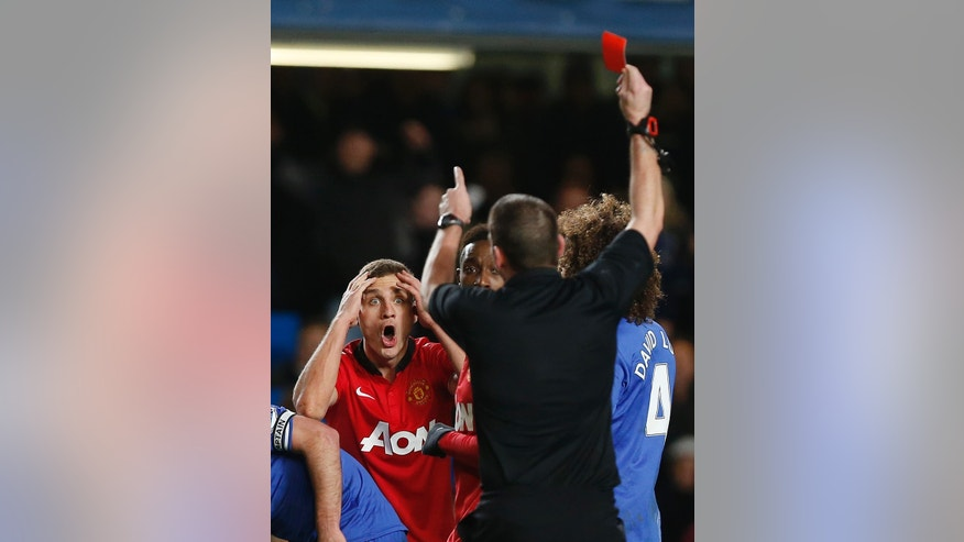 Manchester United's Nemanja Vidic reacts as referee Phil Dowd shows him a red card during the English Premier League soccer match against Chelsea at Stamford Bridge, London, Sunday, Jan. 19, 2014. (AP Photo/Sang Tan)