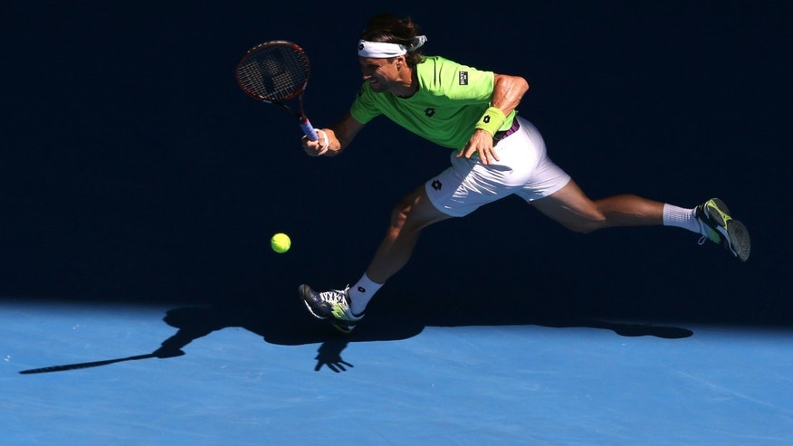 David Ferrer of Spain makes a forehand return to Tomas Berdych of the Czech Republic during their quarterfinal at the Australian Open tennis championship in Melbourne, Australia, Tuesday, Jan. 21, 2014.(AP Photo/Eugene Hoshiko)