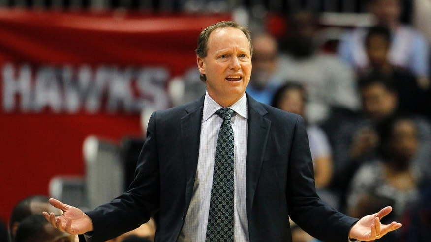 Atlanta Hawks head coach Mike Budenholzer reacts in the second half of an NBA basketball game against the Miami Heat in Atlanta, Monday, Jan. 20, 2014. The Hawks won 121-114 (AP Photo/Todd Kirkland)