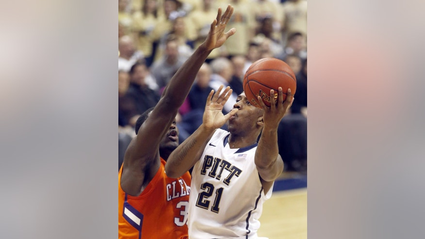 Pittsburgh's Lamar Patterson (21) shoots around Clemson's Landry Nnoko during the first half of an NCAA college basketball game on Tuesday, Jan. 21, 2014, in Pittsburgh. (AP Photo/Keith Srakocic)