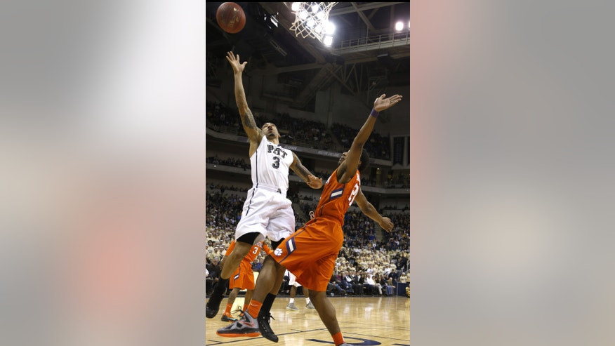 Pittsburgh's Cameron Wright (3) shoots as Clemson's Damarcus Harrison defends during the first half of an NCAA college basketball game on Tuesday, Jan. 21, 2014, in Pittsburgh. (AP Photo/Keith Srakocic)