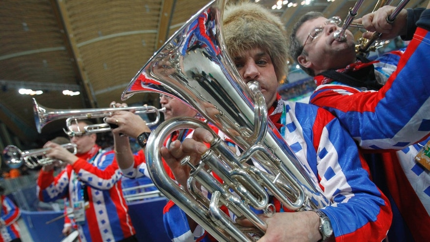 Feb. 17, 2010: This is file photo of the Dutch brass band Kleintje Pils, or Small Beer, entertains the crowd prior to the start of the men's 1000 meters race at the Richmond Olympic Oval at the Vancouver 2010 Olympics in Vancouver, British Columbia.