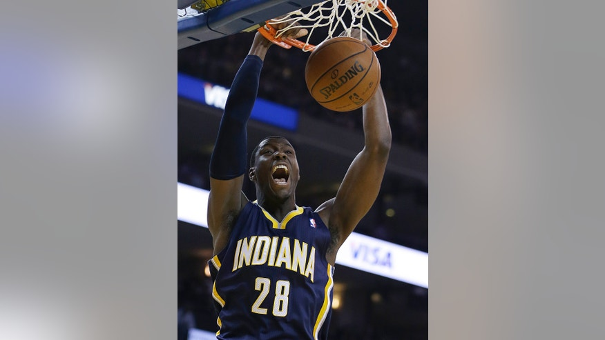 Indiana Pacers' Ian Mahinmi scores against the Golden State Warriors during the first half of an NBA basketball game, Monday, Jan. 20, 2014, in Oakland, Calif. (AP Photo/Ben Margot)