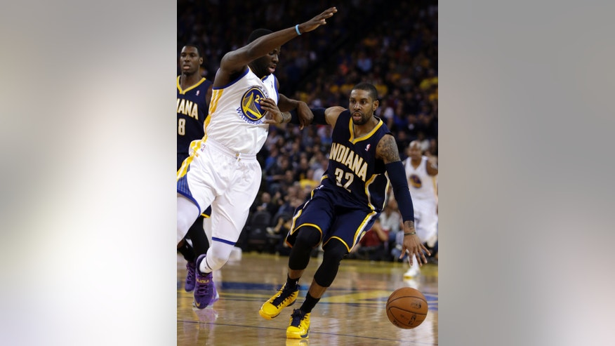 Indiana Pacers' C.J. Watson, right, drives the ball against Golden State Warriors' Draymond Green during the first half of an NBA basketball game, Monday, Jan. 20, 2014, in Oakland, Calif. (AP Photo/Ben Margot)