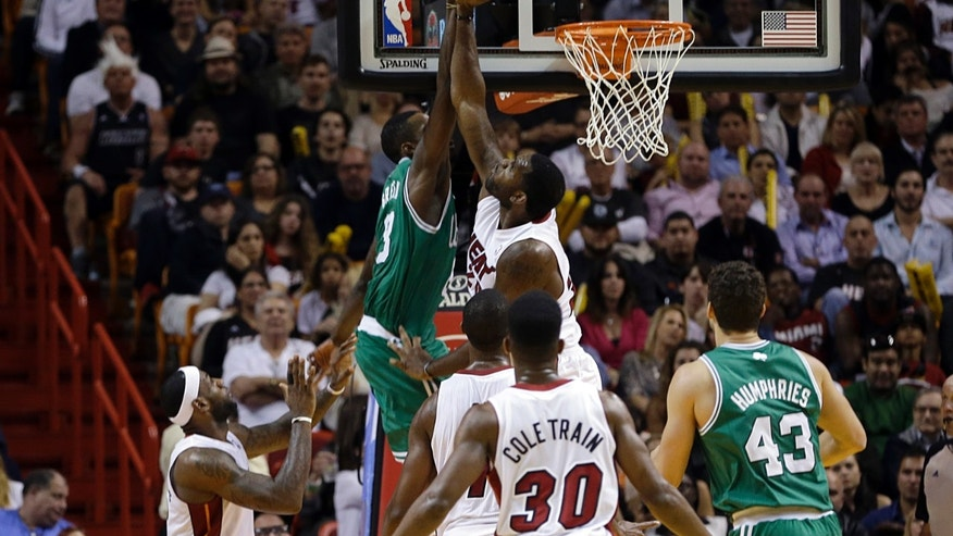 Boston Celtics small forward Jeff Green (8) is blocked by Miami Heat center Greg Oden (20) during the second quarter of an NBA basketball game in Miami, Tuesday, Jan. 21, 2014. (AP PhotoAlan Diaz)