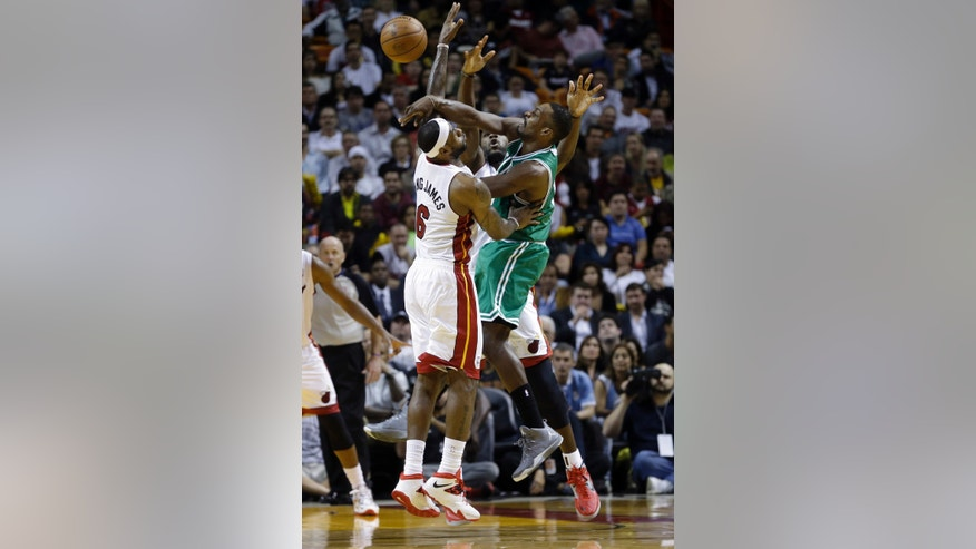 Boston Celtics small forward Jeff Green (8) passes against Miami Heat small forward LeBron James (6) during the second quarter of an NBA basketball game in Miami, Tuesday, Jan. 21, 2014. (AP PhotoAlan Diaz)