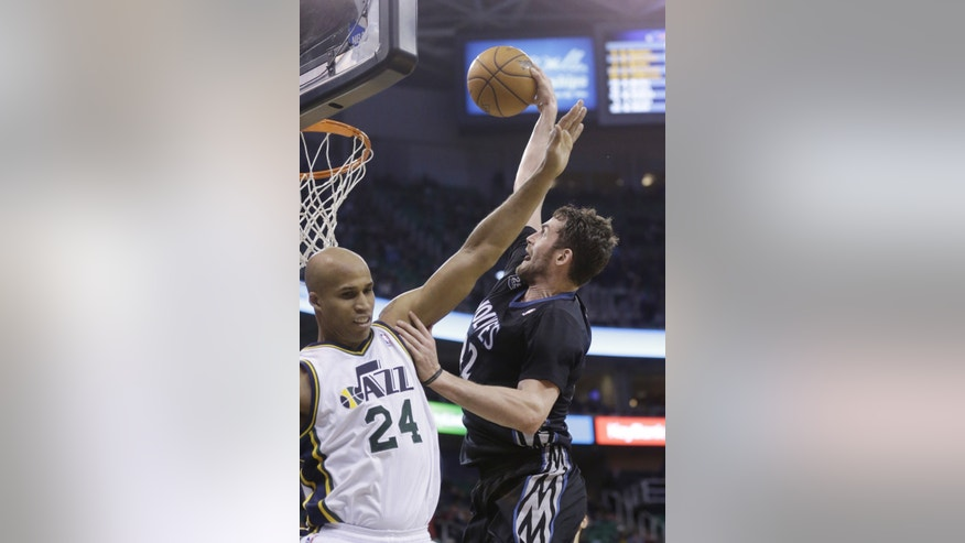 Minnesota Timberwolves' Kevin Love, right, dunks the ball as Utah Jazz's Richard Jefferson (24) defends in the second quarter during an NBA basketball game, Tuesday, Jan. 21, 2014, in Salt Lake City. (AP Photo/Rick Bowmer)
