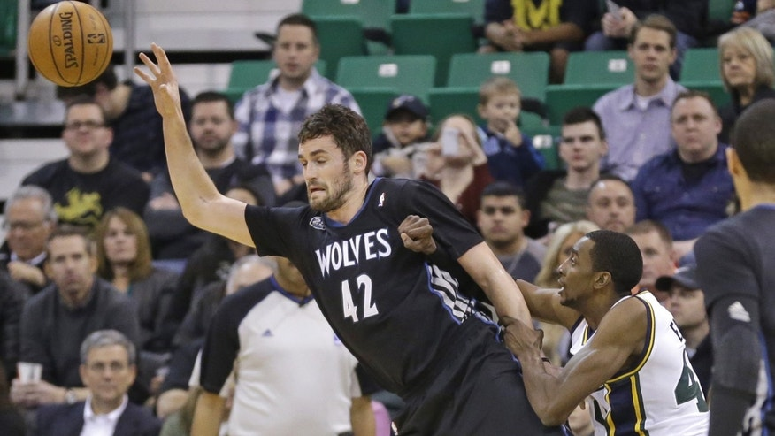 Utah Jazz's Jeremy Evans, right, fouls Minnesota Timberwolves' Kevin Love (42) in the first quarter during an NBA basketball game, Tuesday, Jan. 21, 2014, in Salt Lake City. (AP Photo/Rick Bowmer)