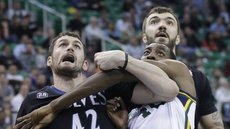 Utah Jazz's Jeremy Evans (40) battles under the boards with Minnesota Timberwolves' Kevin Love (42) and teammate Nikola Pekovic, of Montenegro, in the second quarter during an NBA basketball game, Tuesday, Jan. 21, 2014, in Salt Lake City. (AP Photo/Rick Bowmer)