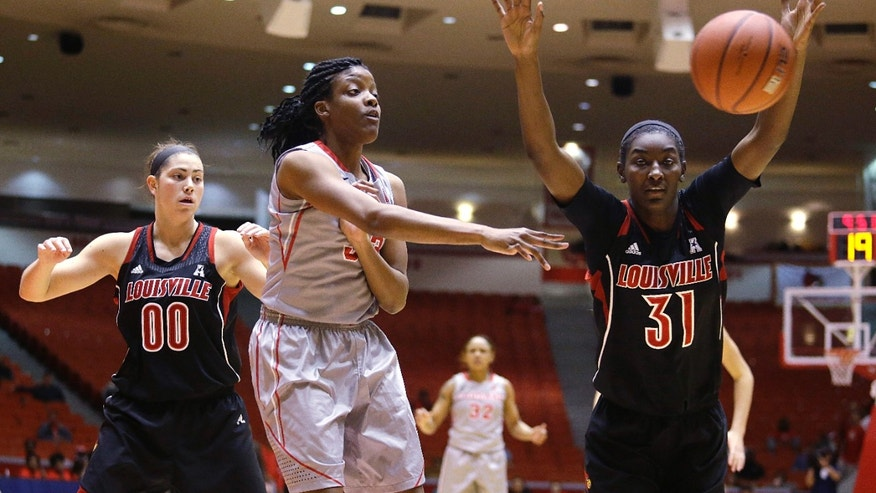 University of Houston forward Tyler Gilbert (33) passes the ball away from Louisville's Asia Taylor (31) and Sara Hammond (00) during the first half of an NCAA women's basketball game, Tuesday, Jan. 21, 2014, in Houston. (AP Photo/Patric Schneider)