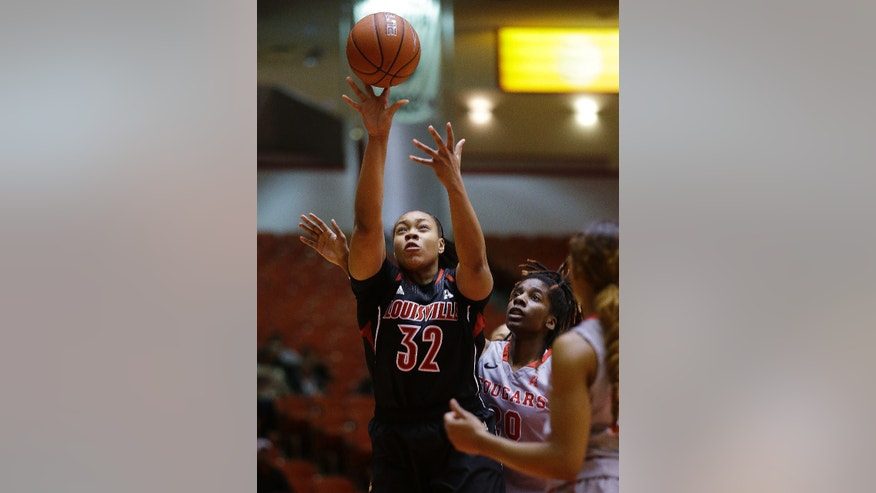 Louisville forward Emmonnie Henderson (32) takes a shot over University of Houston center Yasmeen Thompson during the first half of an NCAA women's basketball game, Tuesday, Jan. 21, 2014, in Houston. (AP Photo/Patric Schneider)