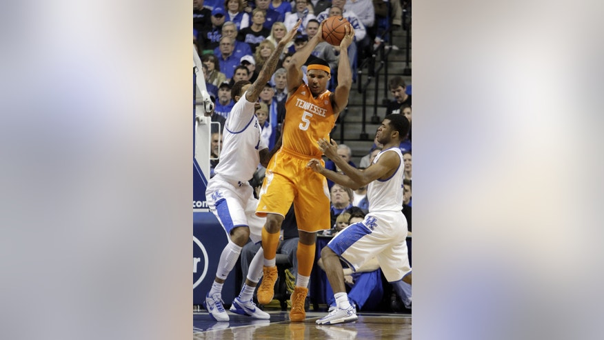 FILE - In htis Jan. 18, 2014, file photo, Tennessee's Jarnell Stokes (5) is pressured by Kentucky's James Young, left, and Andrew Harrison during the second half of an NCAA college basketball game in Lexington, Ky. Stokes' 20-point, 15-rebound outing Saturday in a 74-66 loss at Kentucky showed he's capable of delivering dominant efforts. (AP Photo/James Crisp, File)