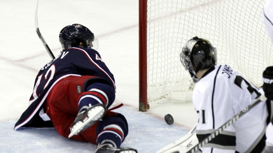 Columbus Blue Jackets' Artem Anisimov, left, of Russia, scores past Los Angeles Kings' Martin Jones in the third period of an NHL hockey game in Columbus, Ohio, Tuesday, Jan. 21, 2014. The Blue Jackets won 5-3. (AP Photo/Paul Vernon)