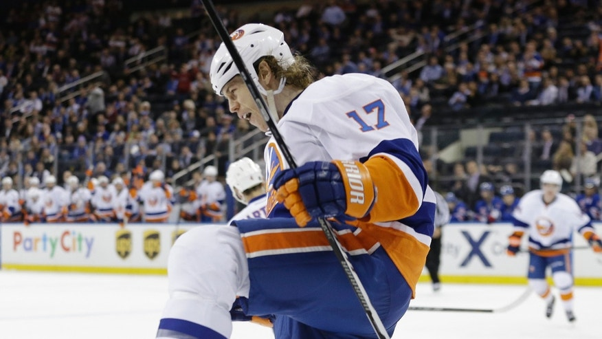 New York Islanders' Matt Martin (17) celebrates after scoring during the first period of an NHL hockey game against the New York Rangers, Tuesday, Jan. 21, 2014, in New York. (AP Photo/Frank Franklin II)