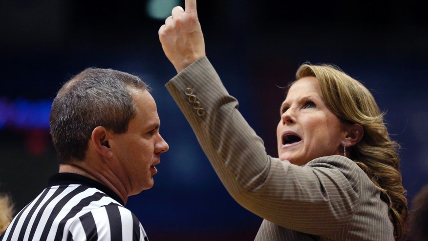 Kansas head coach Bonnie Henrickson, right, talks with referee Mark Zentz, left, during the second half of an NCAA college basketball game against Oklahoma State in Lawrence, Kan., Wednesday, Jan. 22, 2014. Oklahoma State defeated Kansas 64-56.(AP Photo/Orlin Wagner)