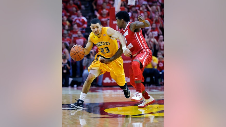 Wichita State guard Fred VanVleet (23) moves the ball down the court under pressure from Illinois State guard Bobby Hunter (4) during the first half of an NCAA college basketball game at Redbird Arena, Wednesday, Jan. 22, 2014, in Normal, Ill. (AP Photo/ Stephen Haas)
