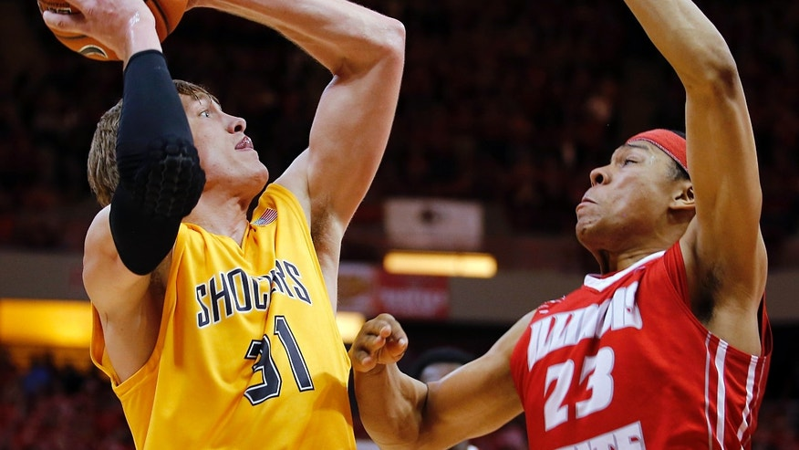 Wichita State guard Ron Baker (31) shoots under pressure from Illinois State guard Zach Lofton (23) during the first half of an NCAA college basketball game at Redbird Arena, Wednesday, Jan. 22, 2014, in Normal, Ill. (AP Photo/ Stephen Haas)