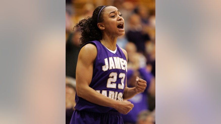 FILE - In this March 14, 2009, file photo, James Madison guard Dawn Evans rallies her team during second half of an NCAA college basketball game in Harrisonburg, Va.  Evans, one of the nation's leading scorers for three years as a point guard at James Madison, has left her professional team in France and returned to Tennessee to prepare for a kidney transplant. (AP Photo/Steve Helber, File)