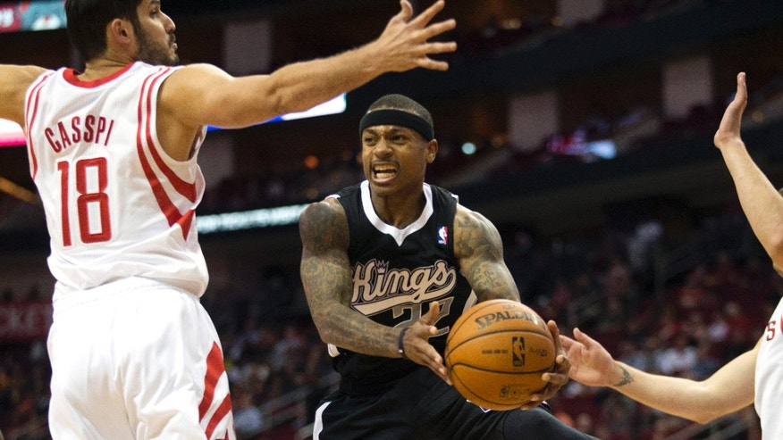 Sacramento Kings guard Isaiah Thomas (22) passes the ball away from Houston Rockets forward Omri Casspi (18) during the first quarter of an NBA basketball game, Wednesday, Jan. 22, 2014, in Houston. (AP Photo/Patric Schneider)
