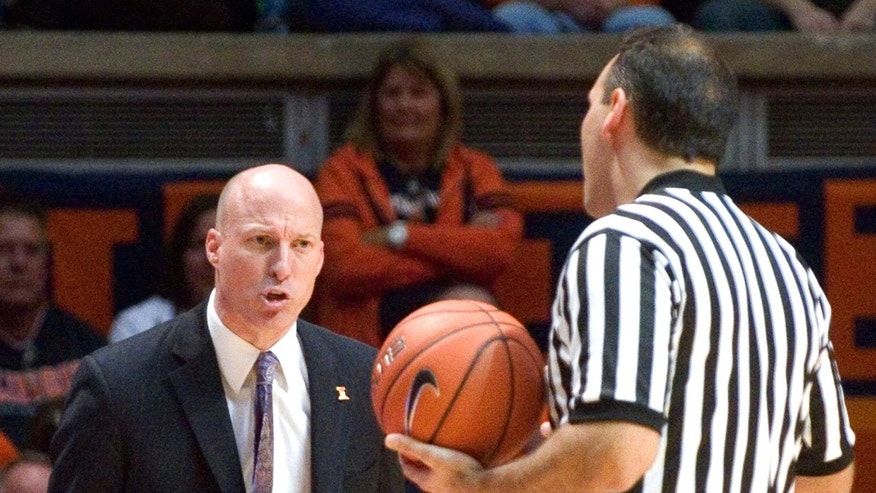 FILE - In this Jan. 18, 2014, file photo, Illinois head coach John Groce has words with a referee during Illinois' 78-62 loss to Michigan State in an NCAA college basketball game in Champaign, Ill. Groce said Wednesday, Jan. 22, 2014, that he went too far in a series of outbursts during the loss. (AP Photo/Robin Scholz, File)