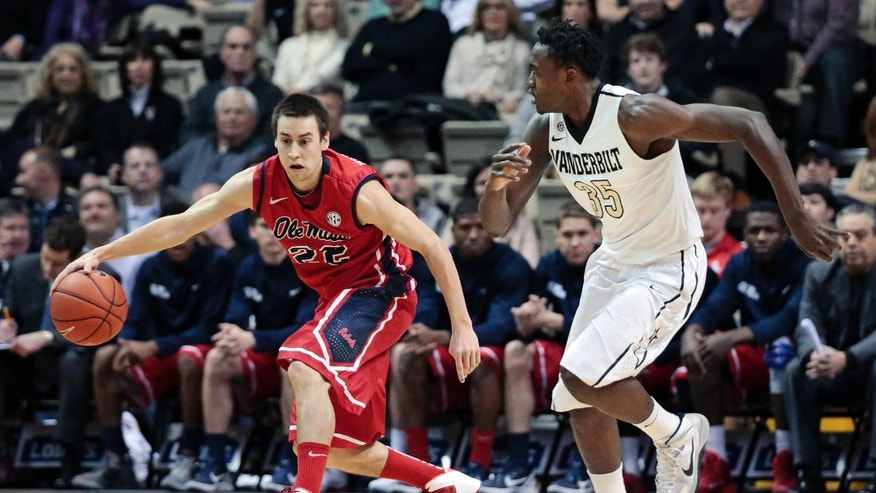 Mississippi guard Marshall Henderson (22) brings the ball down the court as he is defended by Vanderbilt forward James Siakam (35) in the first half of an NCAA college basketball game Wednesday, Jan. 22, 2014, in Nashville, Tenn. (AP Photo/Mark Humphrey)