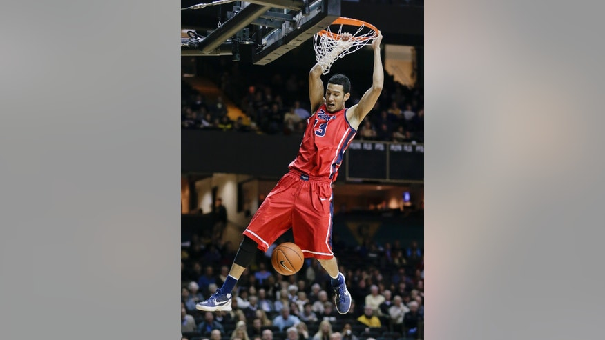 Mississippi forward Anthony Perez dunks the ball against Vanderbilt in the first half of an NCAA college basketball game Wednesday, Jan. 22, 2014, in Nashville, Tenn. (AP Photo/Mark Humphrey)