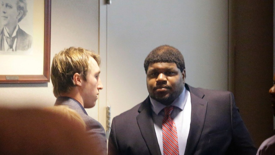 Former Dallas Cowboys NFL football player Josh Brent, right, stands with Dallas Cowboys linebacker Sean Lee in court after closing arguments in his intoxication manslaughter trial Tuesday, Jan. 21, 2014, in Dallas. The jury has begun deliberating in Brent's intoxication manslaughter trial after lawyers wrapped up their closing arguments Tuesday morning. Prosecutors accuse the former defensive tackle of drunkenly crashing his Mercedes near Dallas during a night out in December 2012, killing his good friend and teammate, Jerry Brown. (AP Photo/LM Otero)