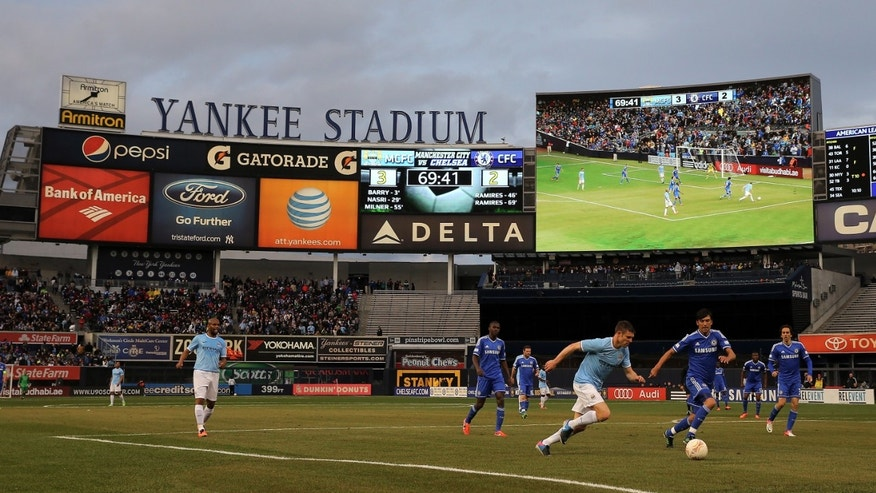 Manchester City heads to the net as Chelsea defends at Yankee Stadium on May 25, 2013 in the Bronx borough of New York City.