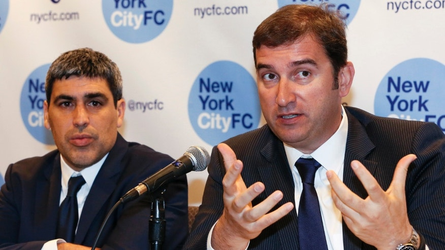 NYCFC Sporting Director Claudio Reyna listens as NYCFC and Manchester City CEO Ferran Soriano on Jan. 10, 2014, in New York.
