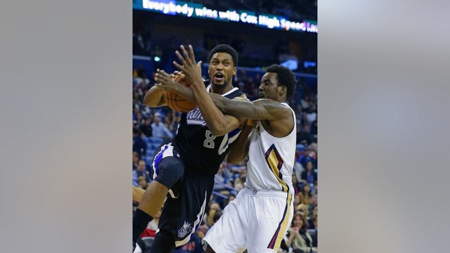 Sacramento Kings small forward Rudy Gay (8) drives to the basket against New Orleans Pelicans small forward Al-Farouq Aminu in the first half of an NBA basketball game in New Orleans, Tuesday, Jan. 21, 2014. (AP Photo/Gerald Herbert)