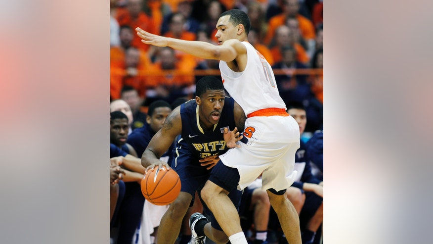 Pittsburgh's Lamar Patterson, left, tries to get past Syracuse's Tyler Ennis, right, in the second half of an NCAA college basketball game in Syracuse, N.Y., Saturday, Jan. 18, 2014. Syracuse won 59-54. (AP Photo/Nick Lisi)